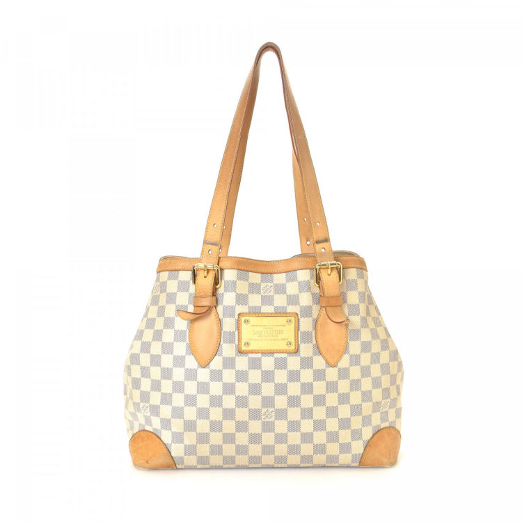LXRandCo guarantees the authenticity of this vintage Louis Vuitton  Hampstead MM tote. This chic work bag was crafted in damier azur coated  canvas in white. c700fcc89