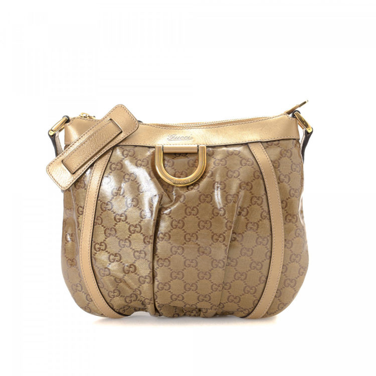 b050c6a55a5c4 LXRandCo guarantees this is an authentic vintage Gucci D-Gold Crossbody Bag  messenger   crossbody bag. Crafted in gg crystal coated canvas