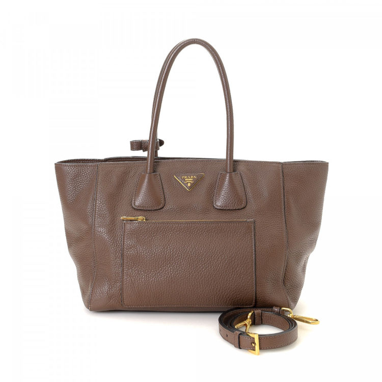 3344211768cb LXRandCo guarantees the authenticity of this vintage Prada Two Way tote.  Crafted in vitello leather