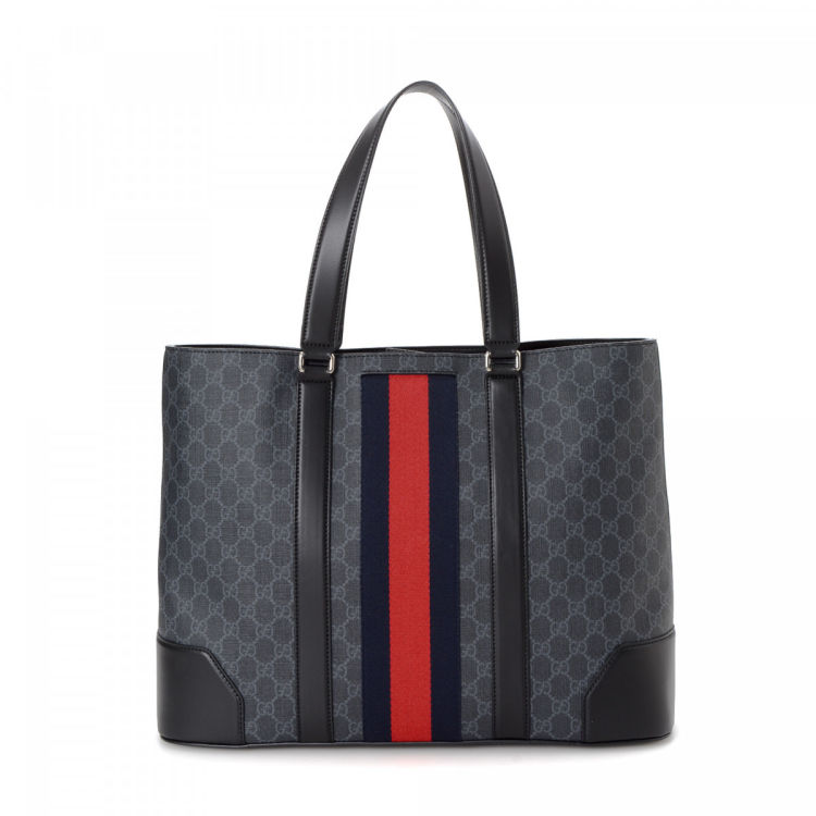fdc6f11ed07563 LXRandCo guarantees this is an authentic vintage Gucci Bag tote. This  stylish bag was crafted in gg supreme coated canvas in beautiful black.