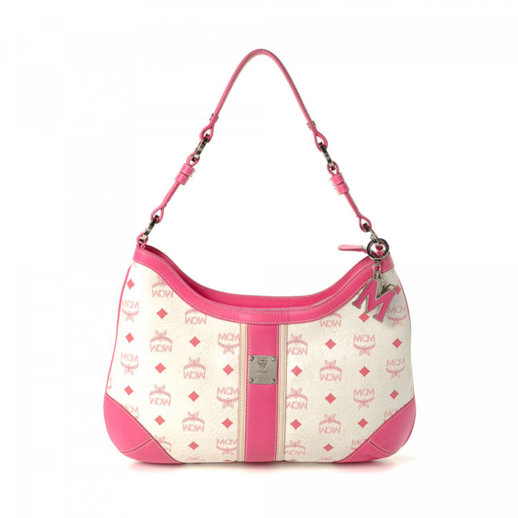 704e87c99 LXRandCo guarantees this is an authentic vintage MCM shoulder bag. This  iconic shoulder bag in beautiful white is made in visetos leather.