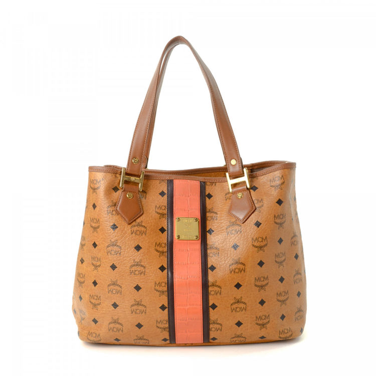 cb9963fd7 LXRandCo guarantees this is an authentic vintage MCM shoulder bag. This  signature shoulder bag was crafted in visetos leather in cognac.