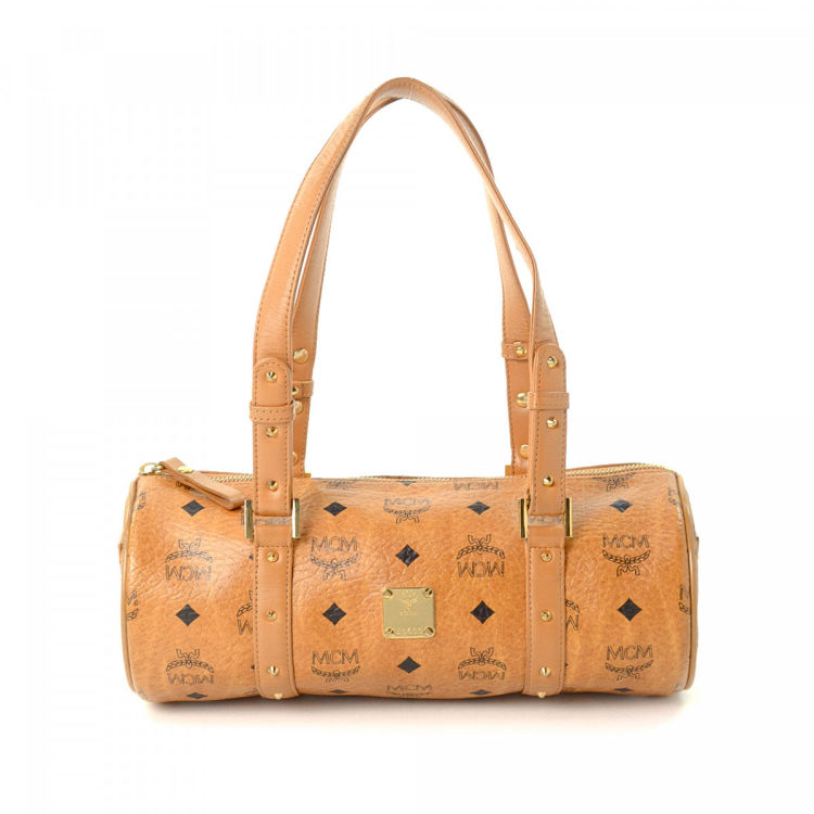 2405f1308 The authenticity of this vintage MCM shoulder bag is guaranteed by LXRandCo.  This elegant satchel in cognac is made in visetos leather.