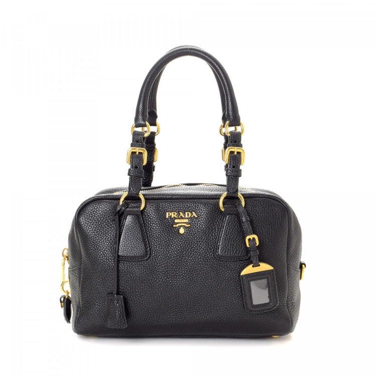 65c165d512 LXRandCo guarantees this is an authentic vintage Prada handbag. This  practical bag in black is made in vitello daino leather. Due to the vintage  nature of ...