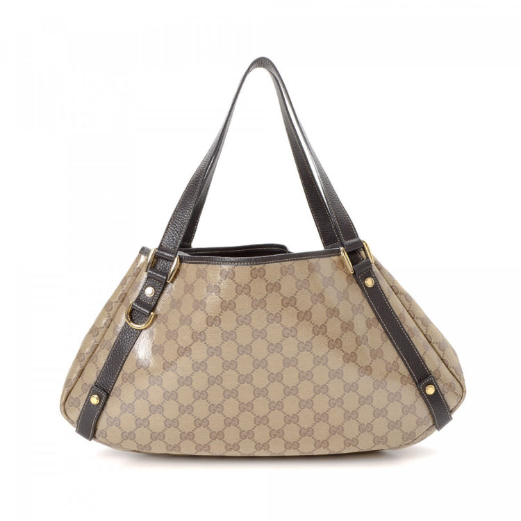 2e36033b9aa16a The authenticity of this vintage Gucci Abbey tote is guaranteed by LXRandCo.  Crafted in gg crystal coated canvas, this classic bag comes in beige.