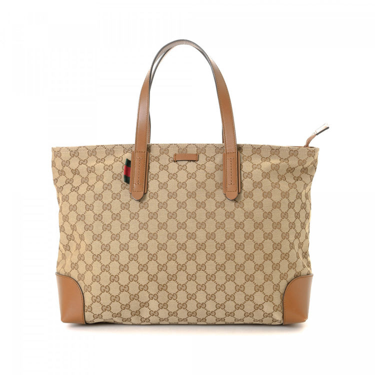 58cac70c0b8 LXRandCo guarantees this is an authentic vintage Gucci tote. Crafted in gg  canvas