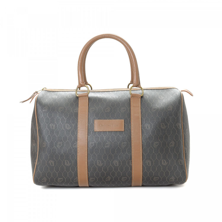 The authenticity of this vintage Dior travel bag is guaranteed by LXRandCo.  This chic carryall in dark grey is made in honeycomb coated canvas. abc94523ec