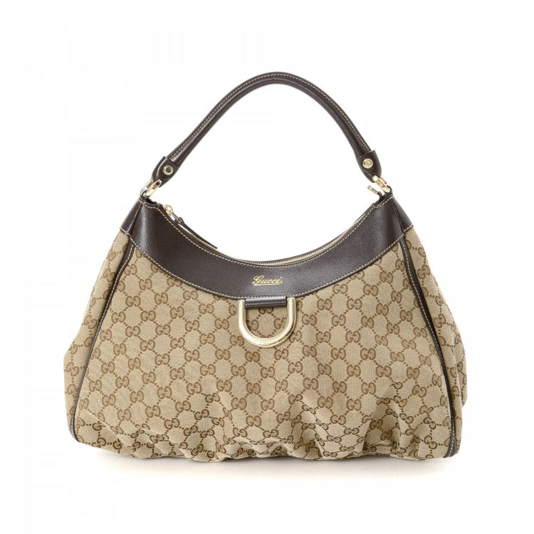 88faa726cd7 LXRandCo guarantees the authenticity of this vintage Gucci D-Gold Hobo Bag  shoulder bag. This beautiful bag was crafted in gg canvas in beige.