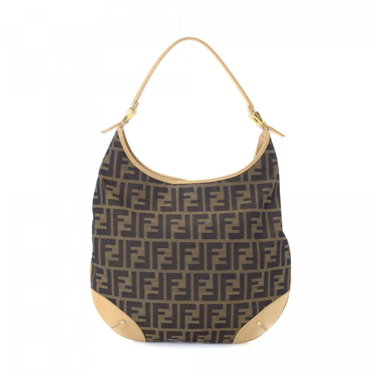 231eae571799 LXRandCo guarantees the authenticity of this vintage Fendi Hobo shoulder bag.  This everyday bag was crafted in zucca canvas in brown.