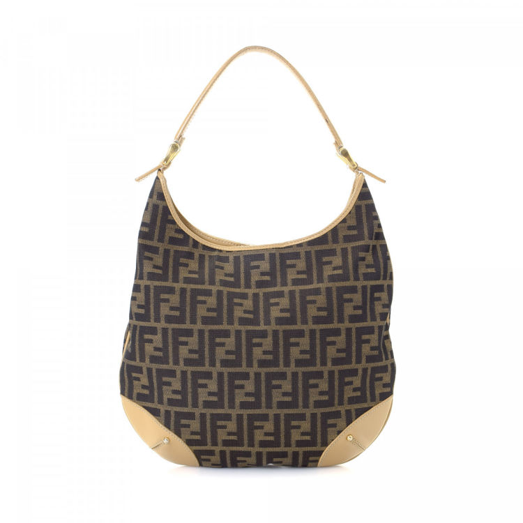 da63f9880ef8 LXRandCo guarantees the authenticity of this vintage Fendi Hobo shoulder  bag. This everyday bag was crafted in zucca canvas in brown.