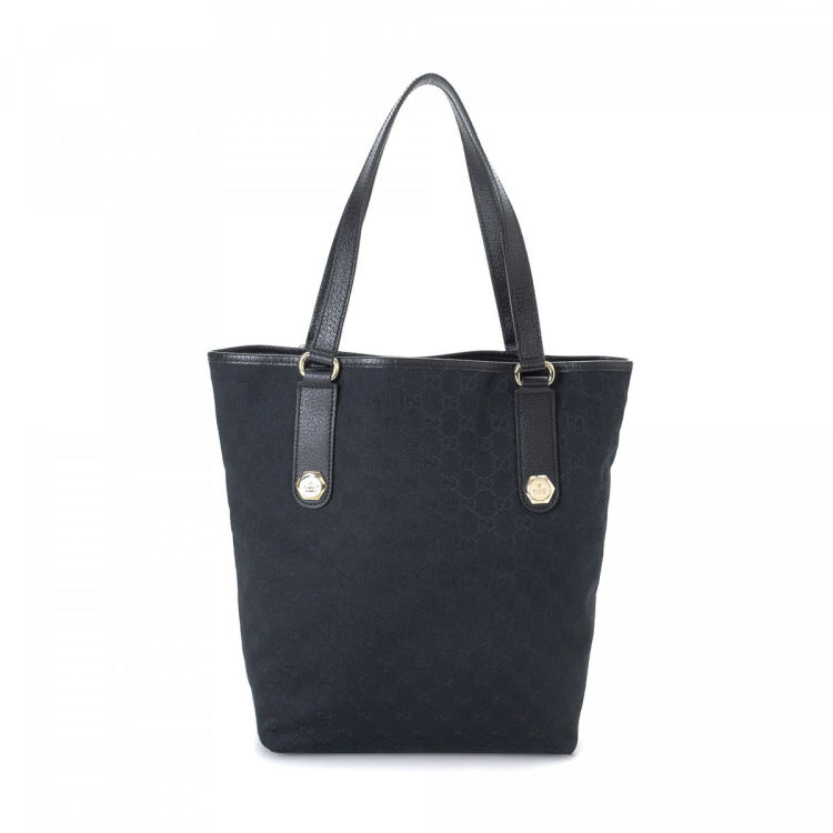 20fd23dac9c LXRandCo guarantees the authenticity of this vintage Gucci Charmy tote.  Crafted in gg canvas