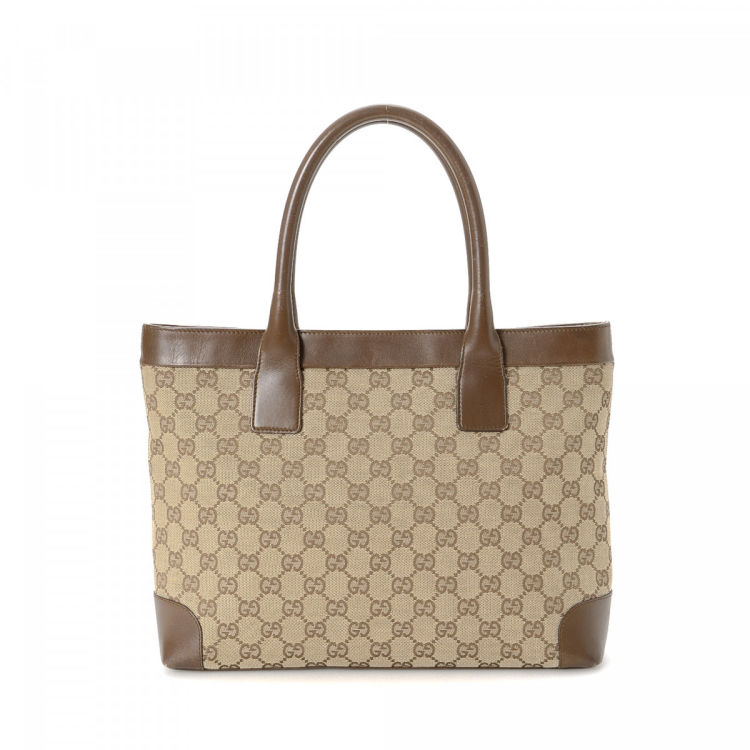 0c28fb5b676e LXRandCo guarantees this is an authentic vintage Gucci tote. This lovely tote  bag was crafted in gg canvas in beautiful beige. Due to the vintage nature  of ...