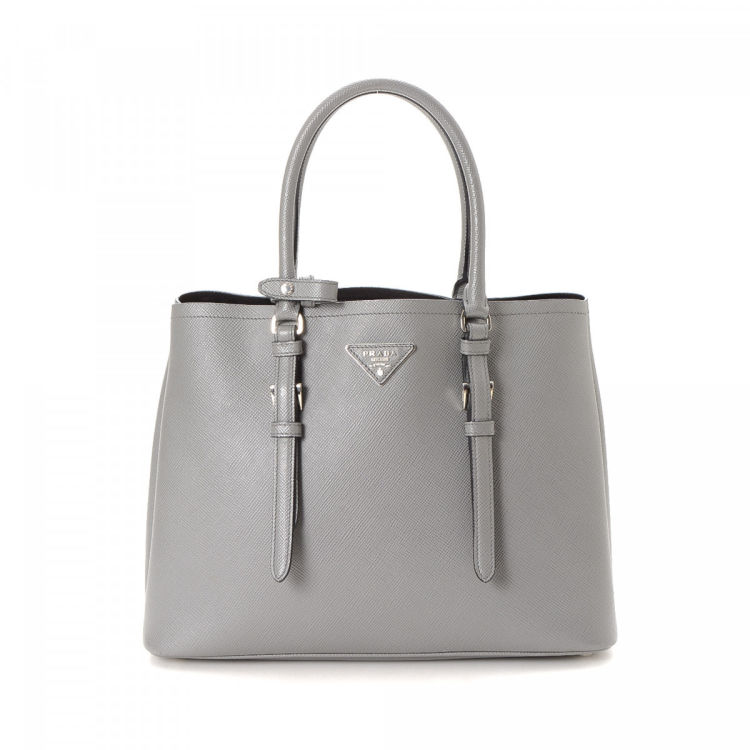 LXRandCo guarantees the authenticity of this vintage Prada handbag. This  luxurious purse in beautiful grey is made in saffiano leather. 2274ab980c977