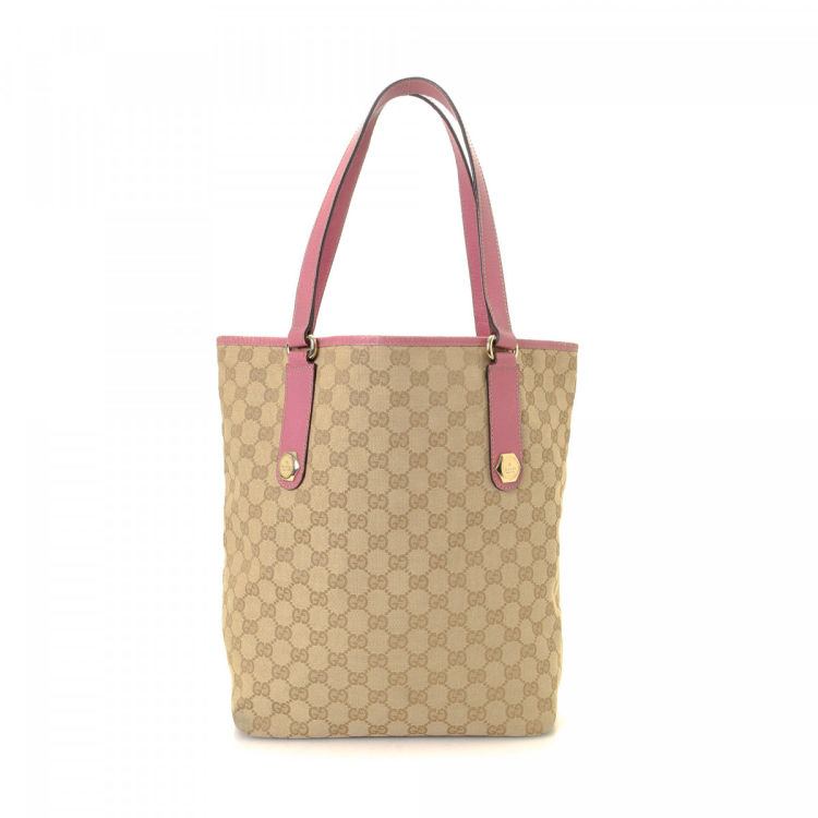 4ba4c2f6e56 LXRandCo guarantees this is an authentic vintage Gucci Charmy tote. Crafted  in gg canvas