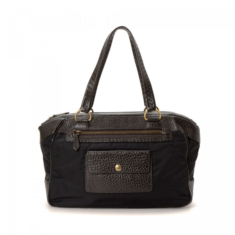 279b68a9b31e LXRandCo guarantees this is an authentic vintage Prada handbag. This lovely  bag in black is made in tessuto leather and nylon. Due to the vintage  nature of ...