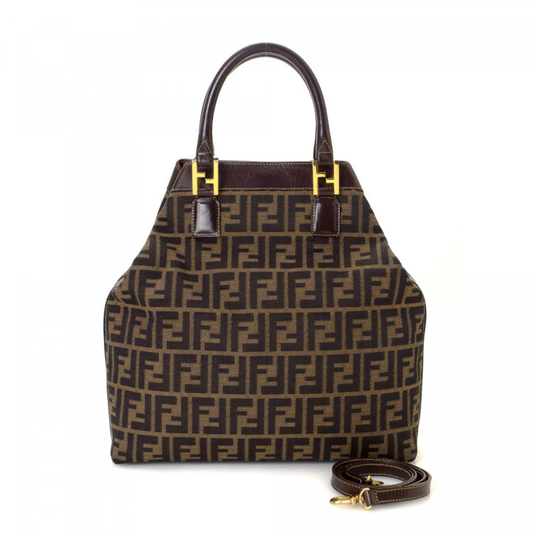 82e6605e6d8c The authenticity of this vintage Fendi Two Way tote is guaranteed by  LXRandCo. This everyday tote was crafted in zucca canvas in brown.