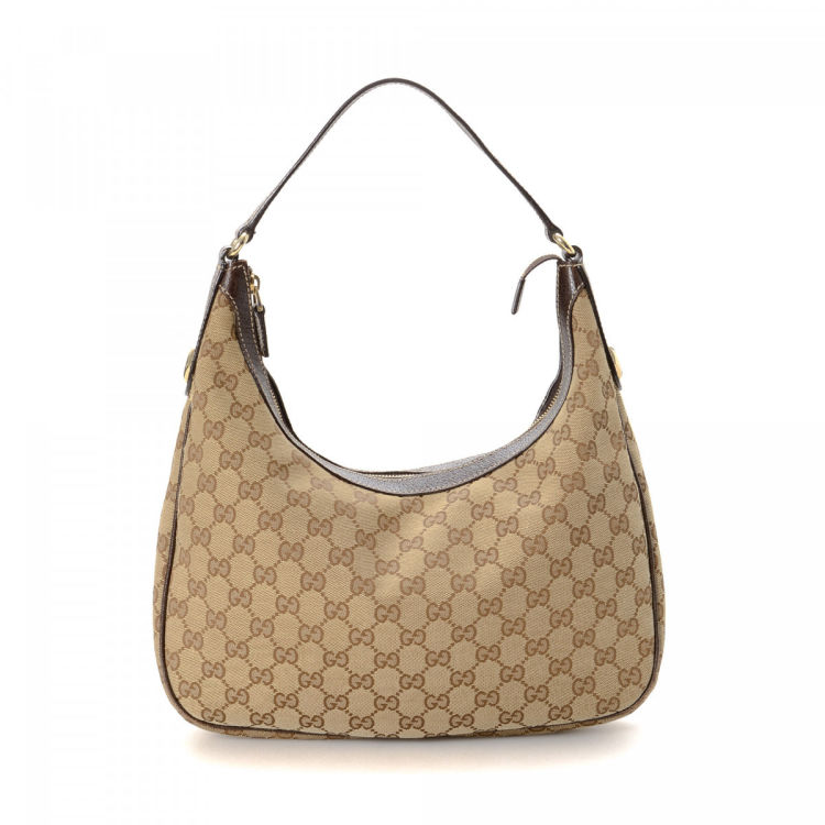 bba39b67fd1 The authenticity of this vintage Gucci Charmy Hobo shoulder bag is  guaranteed by LXRandCo. Crafted in gg canvas