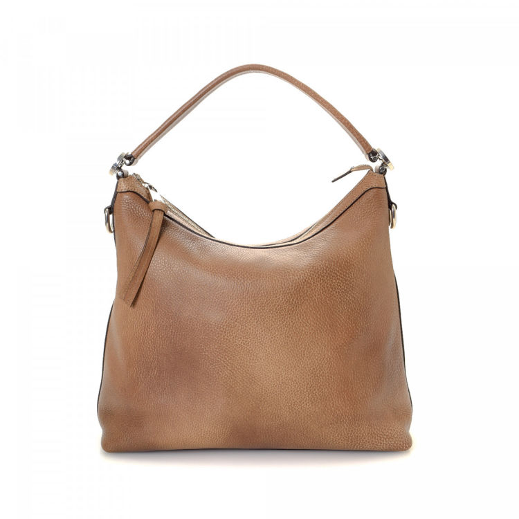 b7f8b8b7352 The authenticity of this vintage Gucci Miss GG Hobo Bag shoulder bag is  guaranteed by LXRandCo. This iconic satchel comes in brown leather.