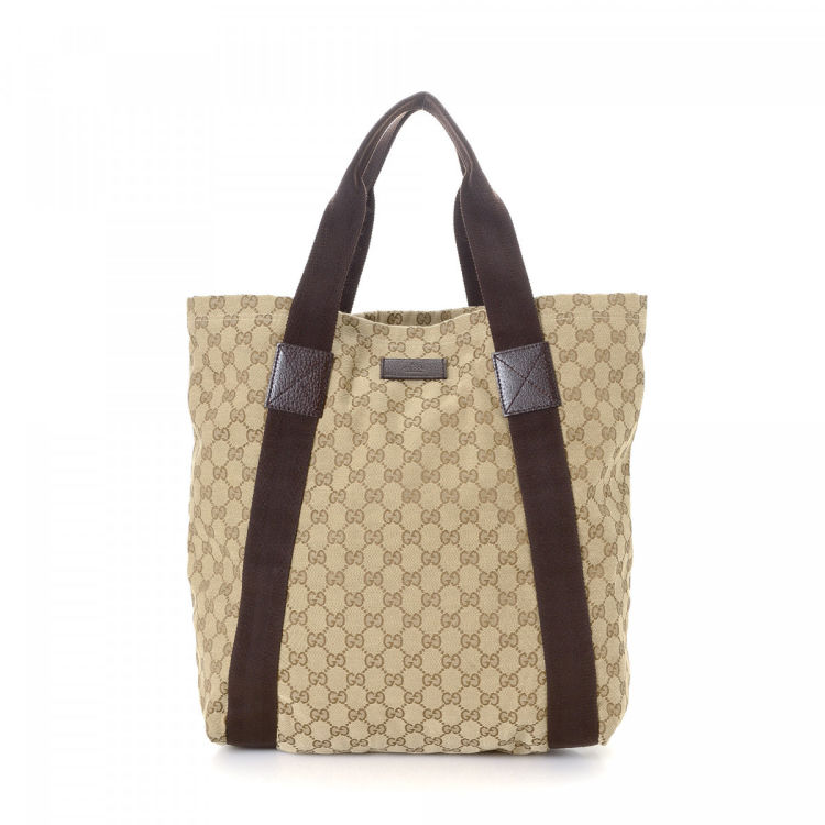 8cbe6bda982b LXRandCo guarantees the authenticity of this vintage Gucci tote. This  elegant tote in beige is made in gg canvas. Due to the vintage nature of  this product, ...