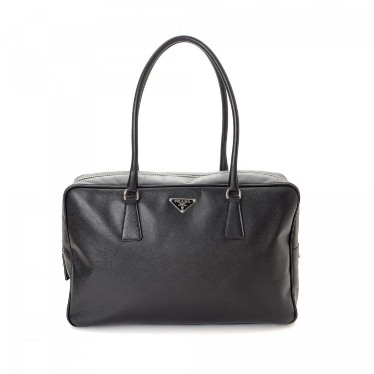 LXRandCo guarantees this is an authentic vintage Prada handbag. This  practical bag in beautiful black is made in saffiano leather. Due to the  vintage nature ... b52e6c05c1dce