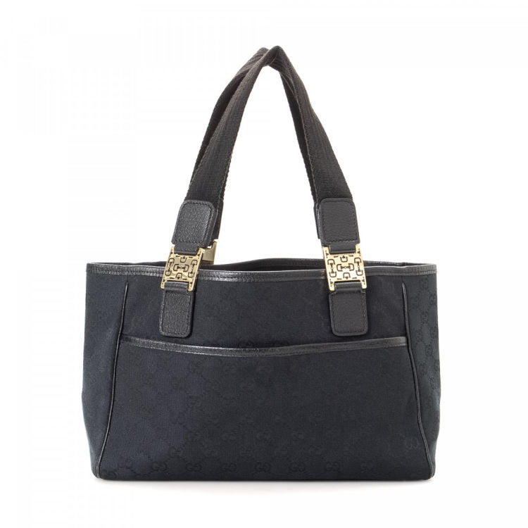 570b51c5a1ba LXRandCo guarantees this is an authentic vintage Gucci tote. This luxurious  bag was crafted in gg canvas in beautiful black. Due to the vintage nature  of ...