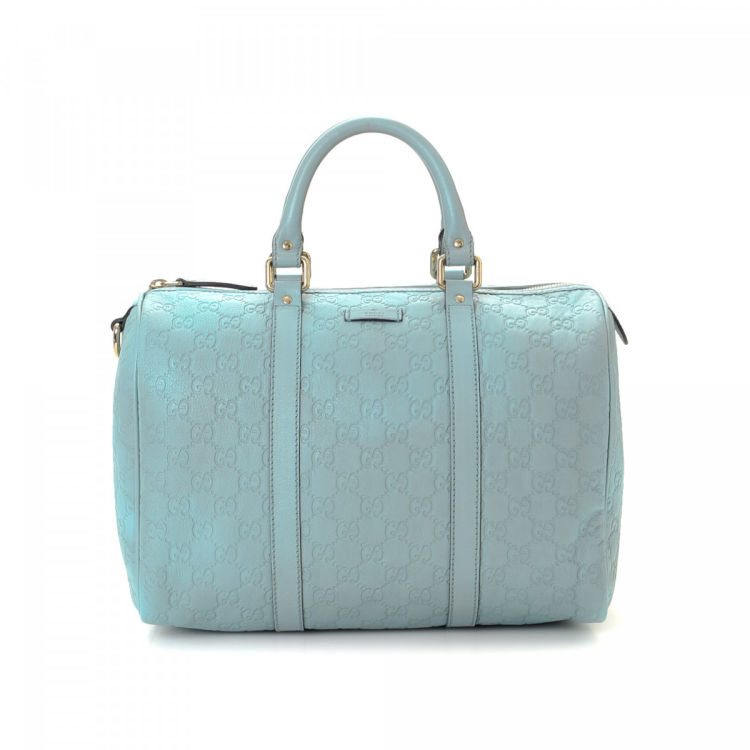 9cf282445c3f The authenticity of this vintage Gucci Joy Boston Bag travel bag is  guaranteed by LXRandCo. This everyday weekend bag in turquoise is made in  guccissima ...
