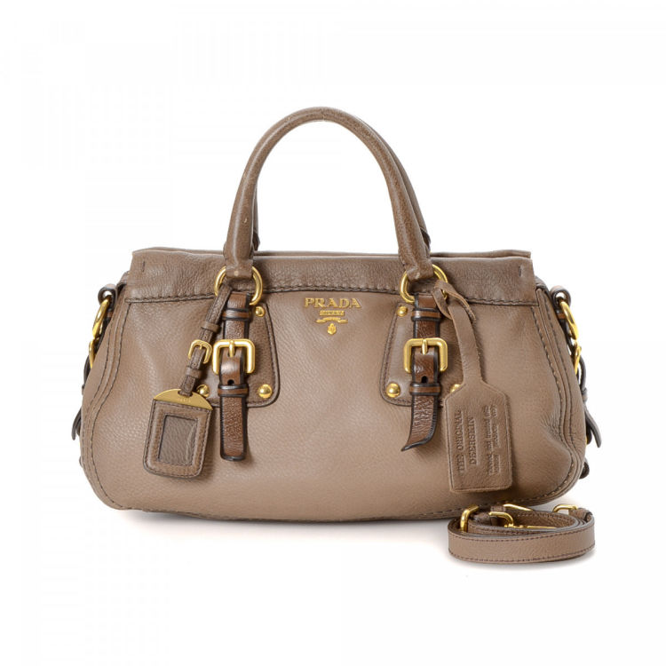 cce7a99be1d1 LXRandCo guarantees the authenticity of this vintage Prada Two Way handbag.  This iconic bag was crafted in cervo leather in beautiful brown.