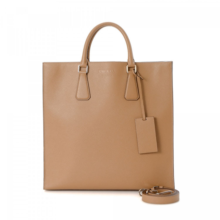 540bf4ffa465 The authenticity of this vintage Prada Two Way tote is guaranteed by  LXRandCo. This signature work bag in brown is made in saffiano leather.