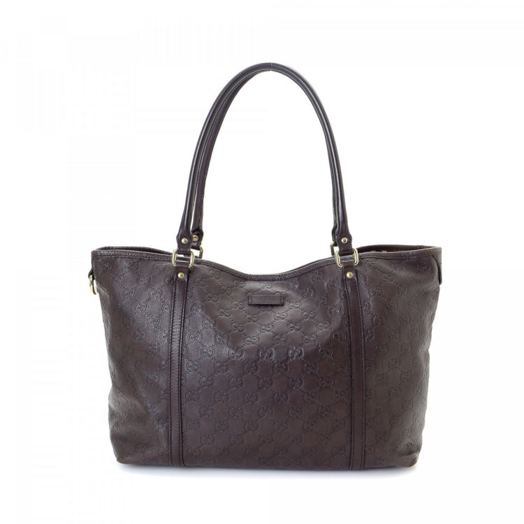 c890b2823f233e LXRandCo guarantees this is an authentic vintage Gucci tote. Crafted in  guccissima leather, this signature tote bag comes in dark brown.