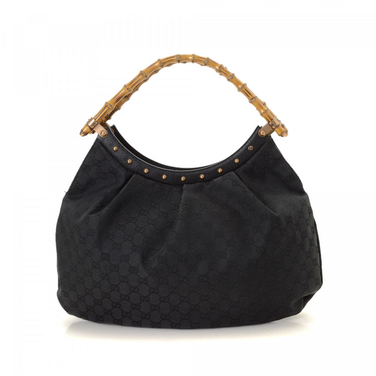7af56eb7d6821a LXRandCo guarantees the authenticity of this vintage Gucci Bamboo shoulder  bag. Crafted in gg canvas, this practical purse comes in black.
