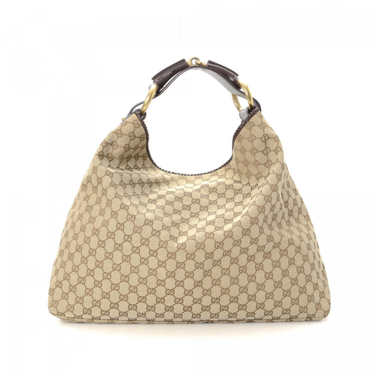 59b1c10cc38 The authenticity of this vintage Gucci Chain Hobo Bag shoulder bag is  guaranteed by LXRandCo. Crafted in gg canvas