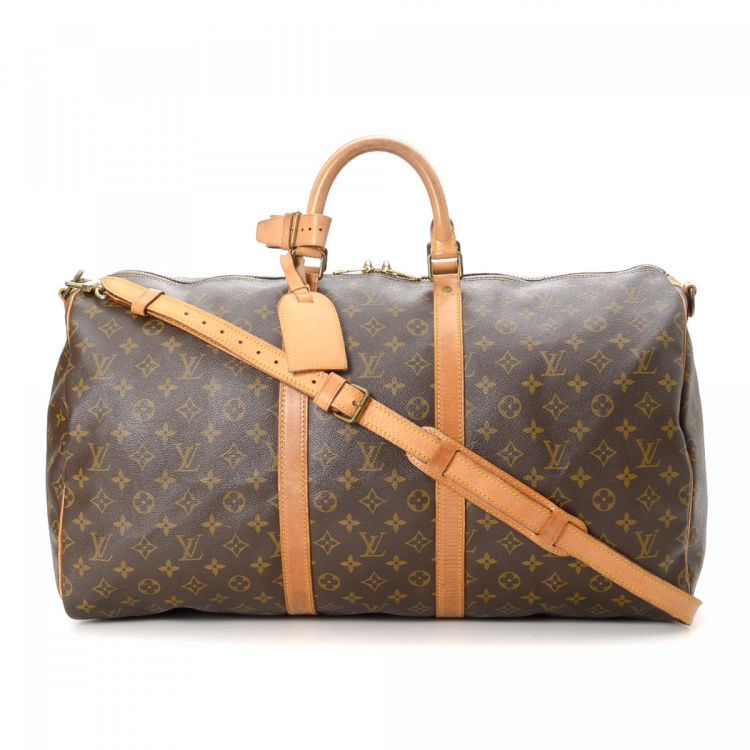 413a2a3943ef LXRandCo guarantees this is an authentic vintage Louis Vuitton Keepall 55  Bandoulière travel bag. This refined weekend bag was crafted in monogram  coated ...