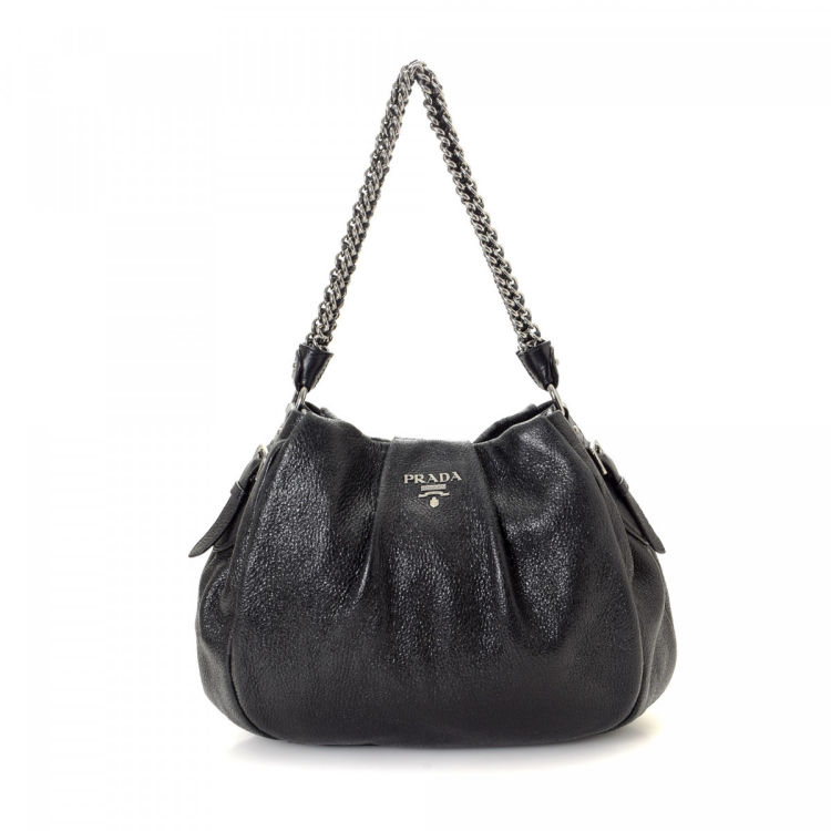 a1c429aba769 LXRandCo guarantees this is an authentic vintage Prada Chain shoulder bag.  This iconic purse was crafted in cervo lux leather in beautiful black.