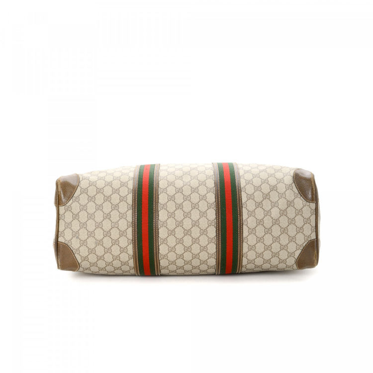 e26af60f8f2 2096208-gucci-gg-supreme-web-travel-bag-gg-supreme-beige-coated-canvas- travel-bags-1aialiq67k.medium.jpg