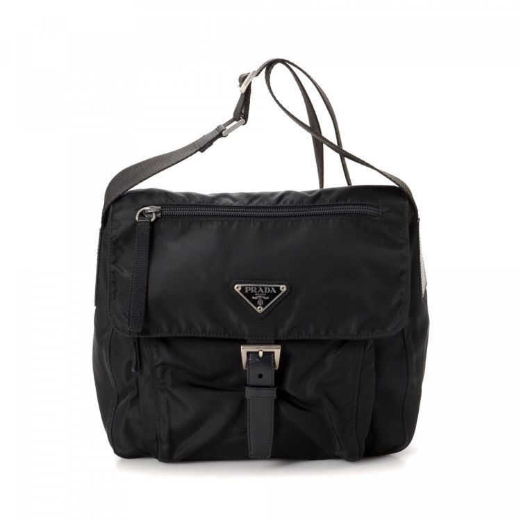 a4e99851969e The authenticity of this vintage Prada Crossbody Bag messenger   crossbody  bag is guaranteed by LXRandCo. This classic crossbody in beautiful black is  made ...