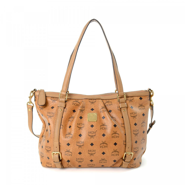 LXRandCo guarantees this is an authentic vintage MCM Two Way tote. This  refined tote bag was crafted in visetos leather in beautiful cognac. 0774150c4f4ca