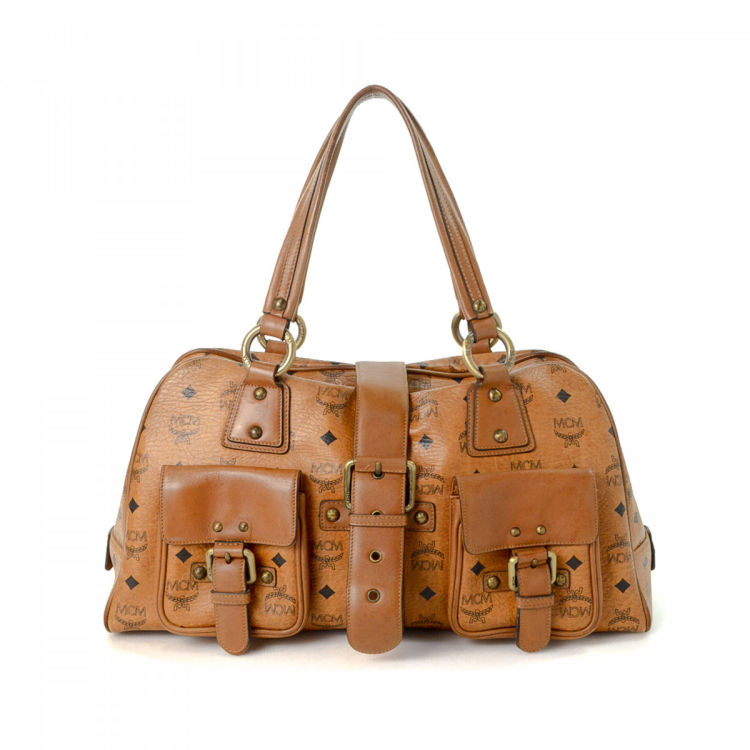 79a0a029d LXRandCo guarantees this is an authentic vintage MCM shoulder bag. Crafted  in visetos leather, this lovely satchel comes in beautiful cognac.