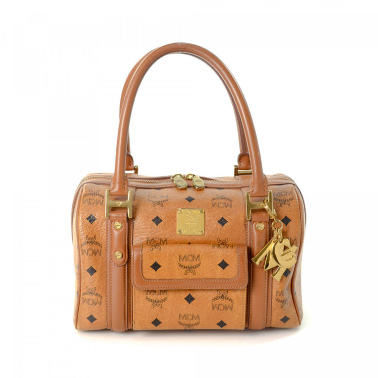 b281a4f73 LXRandCo guarantees the authenticity of this vintage MCM Boston Bag handbag.  This stylish purse in cognac is made in visetos leather.