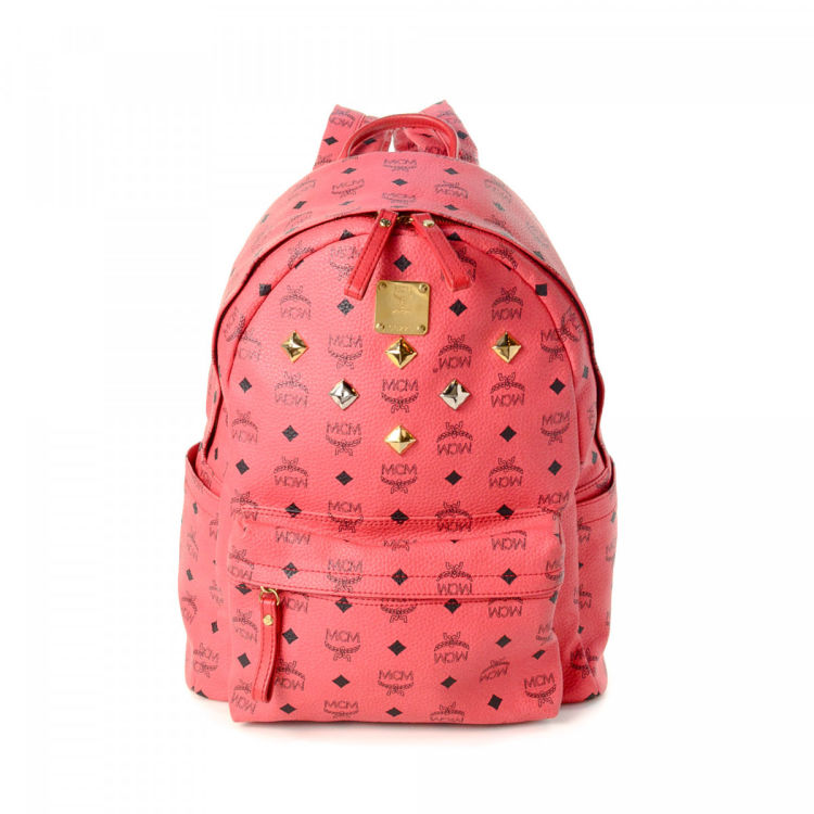 962401a5b LXRandCo guarantees this is an authentic vintage MCM backpack. This  practical backpack was crafted in visetos leather in hot pink. Due to the  vintage nature ...