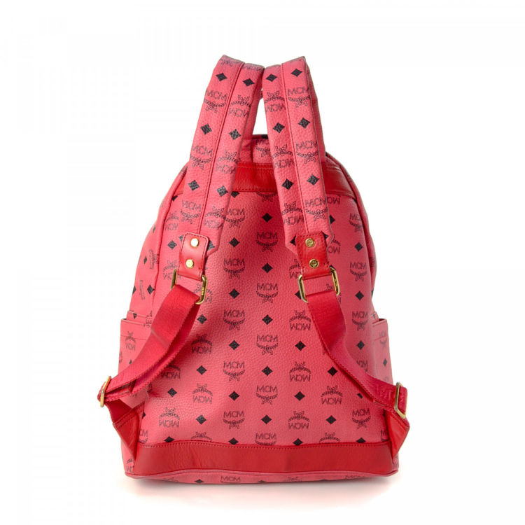 0a362b568 The authenticity of this vintage MCM backpack is guaranteed by LXRandCo.  This classic backpack in hot pink is made in visetos leather.