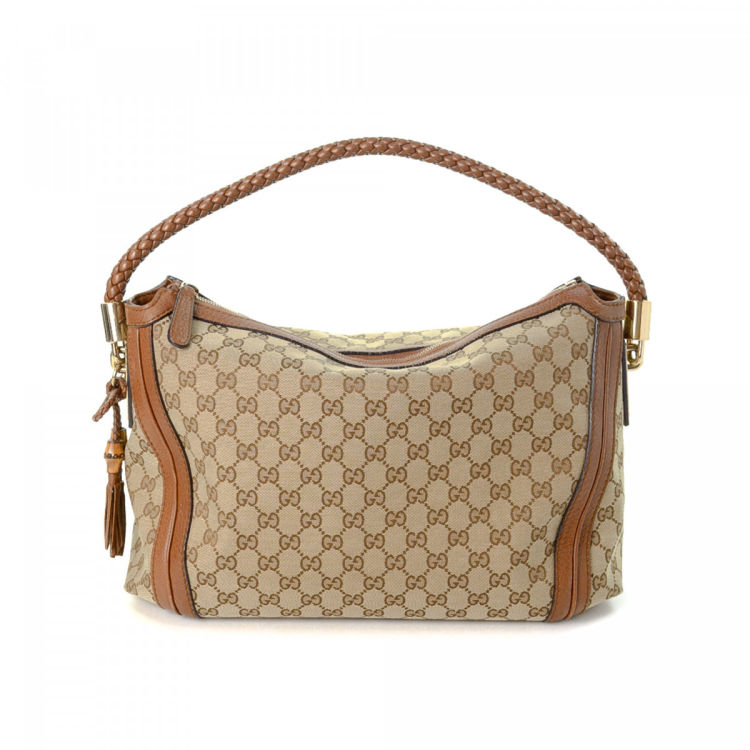 3b9dd952b77 The authenticity of this vintage Gucci Bella Hobo Bag shoulder bag is  guaranteed by LXRandCo. This lovely satchel was crafted in gg canvas in  beige.