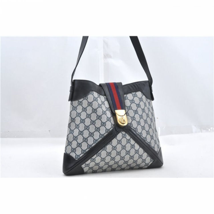 3738accfbd61f7 The authenticity of this vintage Gucci Web shoulder bag is guaranteed by  LXRandCo. This exquisite satchel was crafted in gg supreme coated canvas in  ...