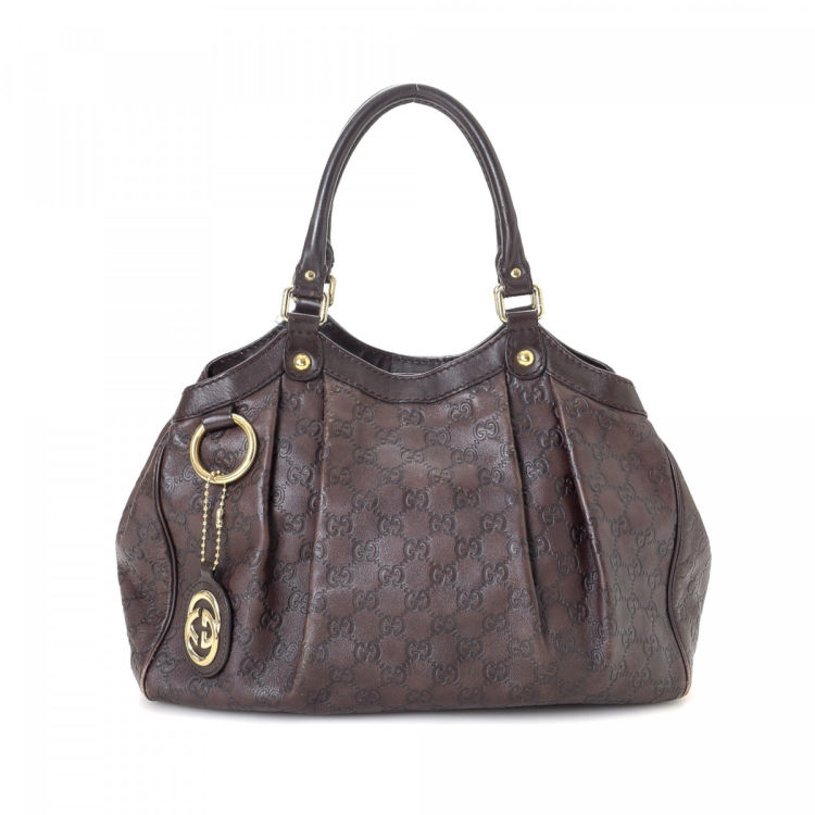 115aa77fcb8a81 The authenticity of this vintage Gucci sukey tote is guaranteed by LXRandCo.  This lovely work bag was crafted in guccissima leather in dark brown.