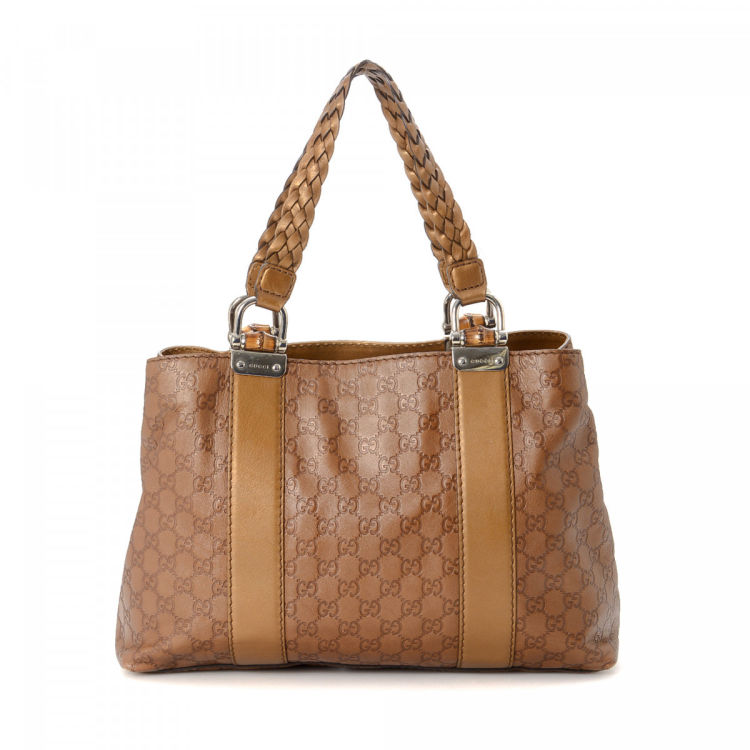 e71c106823fe6c LXRandCo guarantees the authenticity of this vintage Gucci Bamboo Bar tote.  This iconic bag was crafted in guccissima leather in bronze.