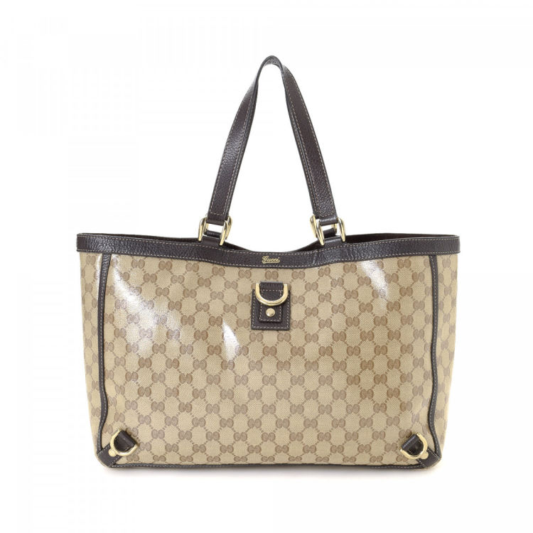 34e86d96fd1f LXRandCo guarantees the authenticity of this vintage Gucci Abbey tote.  Crafted in gg crystal coated canvas, this sophisticated bag comes in beige.