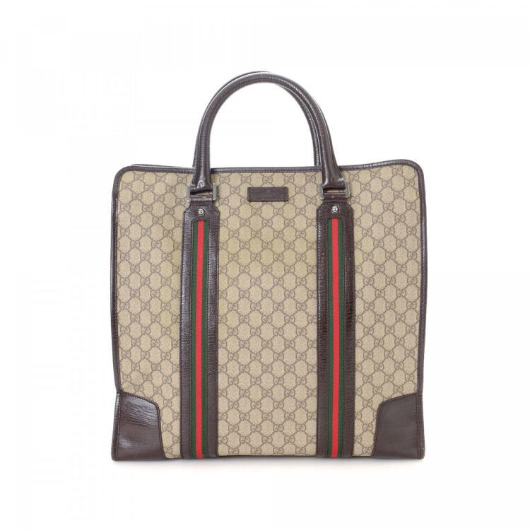 8779574b4b4 LXRandCo guarantees this is an authentic vintage Gucci Web tote. Crafted in gg  supreme coated canvas