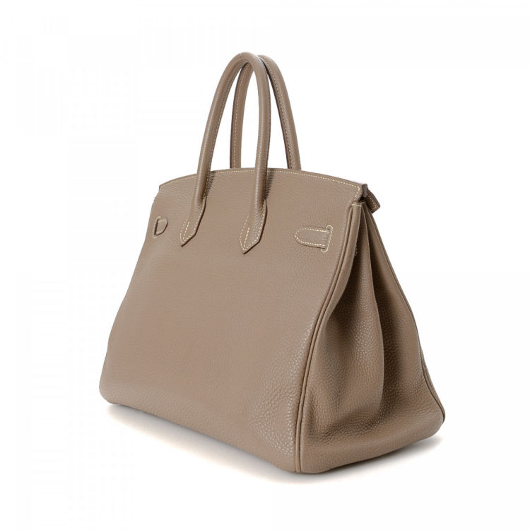 b192c3dadd2d LXRandCo guarantees the authenticity of this vintage Hermès Birkin 35  handbag. This stylish handbag was crafted in togo calf in etoupe.