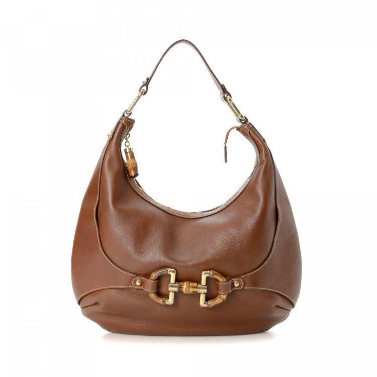 620ad4950ad The authenticity of this vintage Gucci Amalfi Hobo Bag shoulder bag is  guaranteed by LXRandCo. This iconic satchel in brown is made of leather.