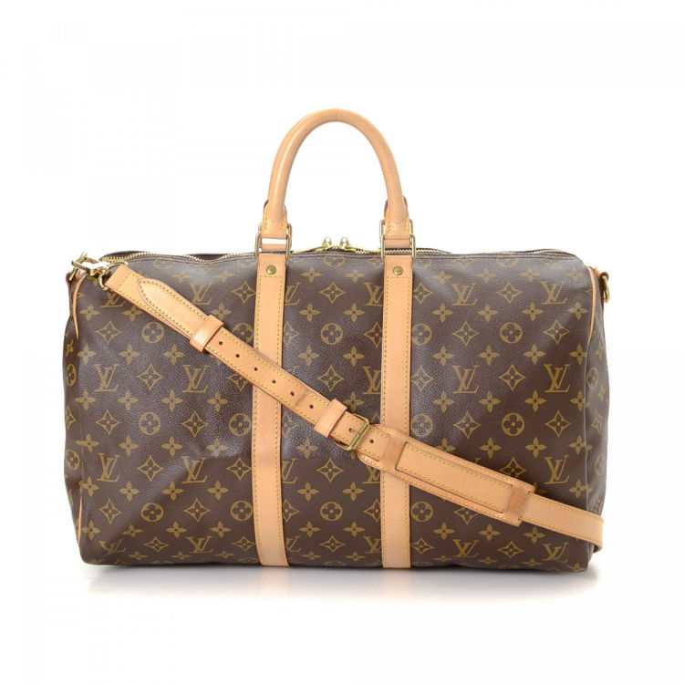 030b3824e718 ... authenticity of this vintage Louis Vuitton Keepall 45 Bandoulière  travel bag. This chic boston bag in beautiful brown is made in monogram  coated canvas.