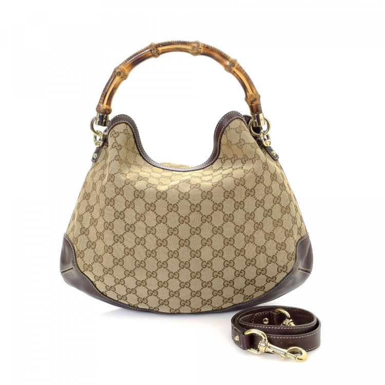 dd840791d34 LXRandCo guarantees the authenticity of this vintage Gucci Pey Hobo  shoulder bag. Crafted in gg canvas